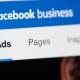 Facebook business page for advertising on laptop screen close-up